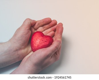 Man holding a red heart, health insurance, donation charity concept, world health day, world heart day, heart care, all lives matter concept