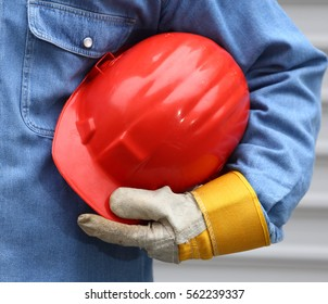 Man holding red helmet close up
