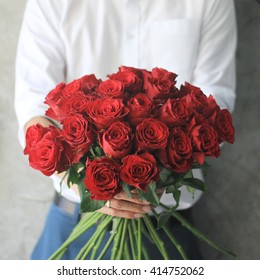 Man holding red roses.