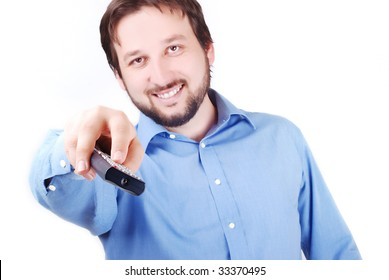 Man is holding remote control and looking in front of him