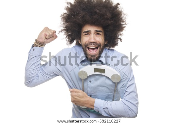 Man holding scale in front of a white background