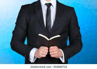 A man holding a schedule book