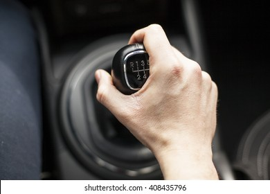 man holding shift lever handle focus on hand