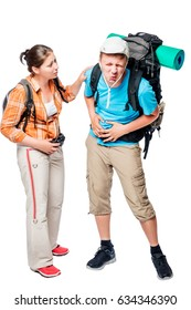 Man holding a sick stomach with his hands, near  a woman with a backpack
