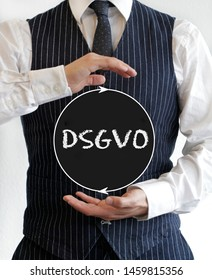 Man holding a sign with the acronym DSGVO (German for GDPR - General Data Protection Regulation) written on it