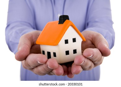 man holding a small house in his hands