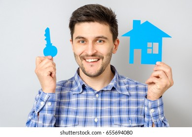 Man holding small model of house. Buying a house concept