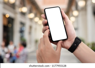 Man holding smart phone with blurred background. For Graphic display montage,copy space warm colours sun light