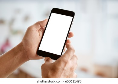 Man holding smart phone with blurred backgroung. Blank screen for Graphic display montage.