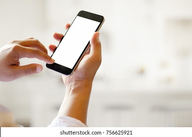 Man holding smart phone with blurred background. For Graphic display montage.