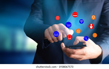 man holding smart phone with online icons
