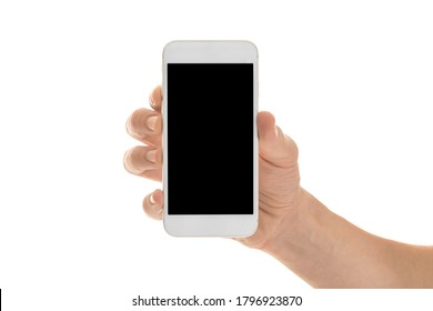 Man holding a smartphone with empty black screen. Mobile phone in a vertical position in hands and isolated on white background. High quality studio shot. Man shows the phone screen to the camera.