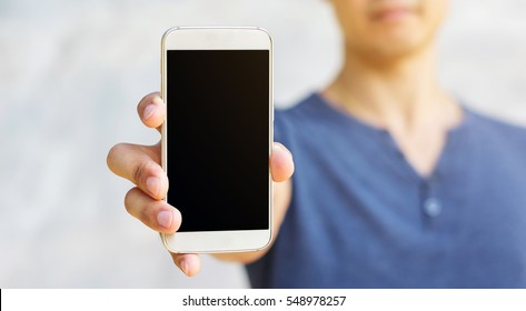 Man holding a smartphone in his hand.