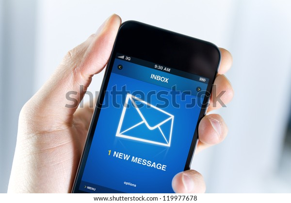 A man holding smartphone with one new message on a screen. Closeup shot.