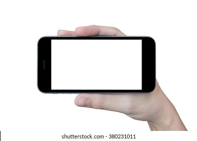 A man is holding a smartphone with white blank screen, landscape oriented on isolated white background.