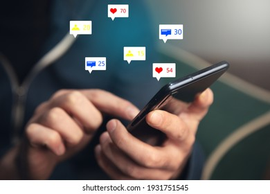 man holding social media icons with smart phone