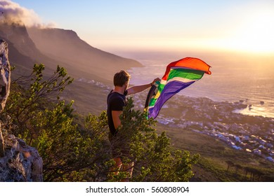 Man holding a south african flag over Cape Town