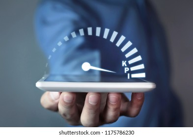 Man holding speedometer with KPI word. Key Performance Indicator. Business concept