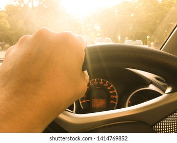 Man holding steering wheel when driving on the road. Transportation, safety, driving carefully, lifestyle and traffic concept