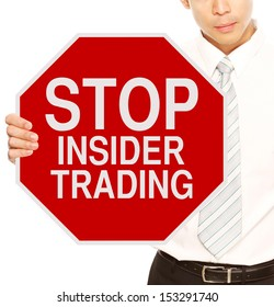 A man holding a stop sign on Insider Trading