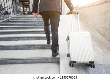 Man holding suitcase. businessman with luggage travels, goes to a business meeting