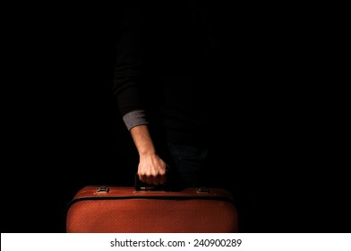 man holding a suitcase for a trip