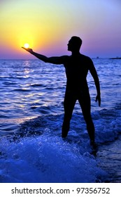 Man holding the sun in his hand