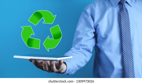 Man holding tablet with Recycle symbol.