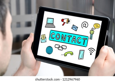 Man holding a tablet showing contact concept