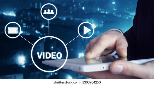 Man holding tablet with Video sign. Video marketing