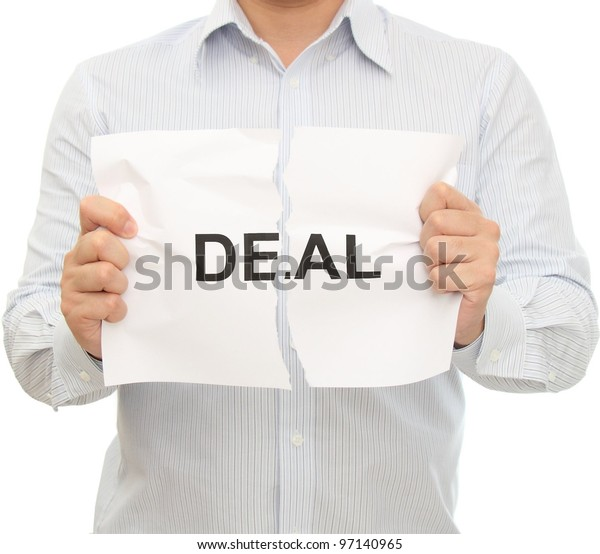 """Man holding a torn paper which says """"Deal"""""""