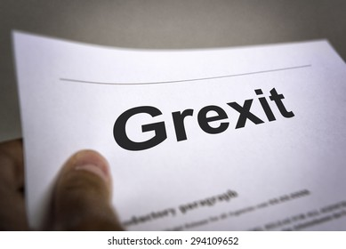 Man holding an treaty with title Grexit