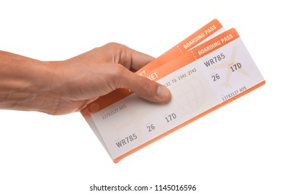 Man is holding two tickets for the plane. Isolated on white background