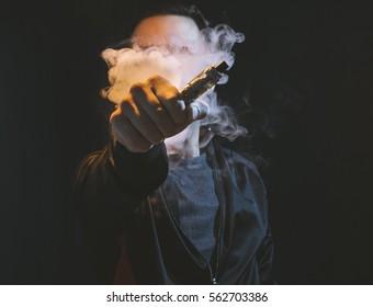 Man holding vaping device