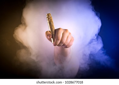 Man holding vaping device in colour smoke