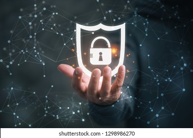 man holding virtual icon  shield with a lock symbol, concept about security, cybersecurity and protection against dangers
