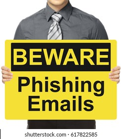 A man holding a warning sign on Phishing Emails