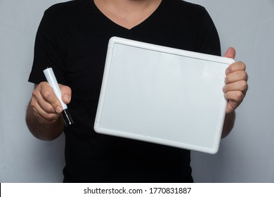 man holding whie board and marker