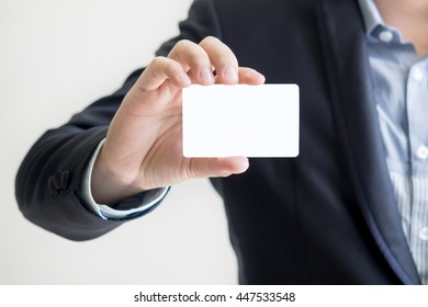 man holding white business card - for write the message in card