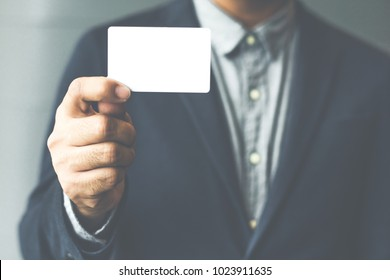 Mock up business card images stock photos vectors shutterstock man holding white business cardman wearing blue shirt and showing blank white business card colourmoves