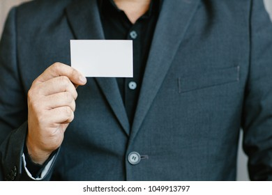 Business cards templates stock photos images photography man holding white business cardman wearing blue shirt and showing blank white business card colourmoves