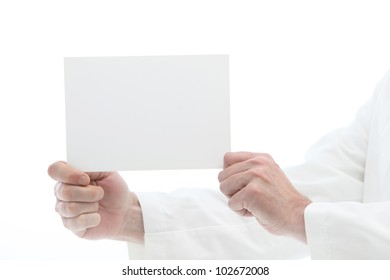 Man holding white card off to the side for reading Man holding blank white card with room for your message or text off to the side for reading