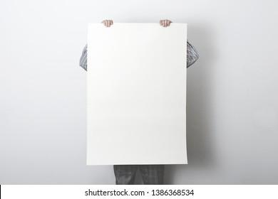 man holding white customizable empty poster