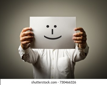 Man is holding white paper with smile. Happy and smile concept.