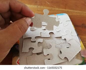 Man holding white puzzle