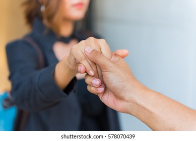 Man holding woman's hand with love