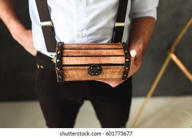 Man holding a wooden box