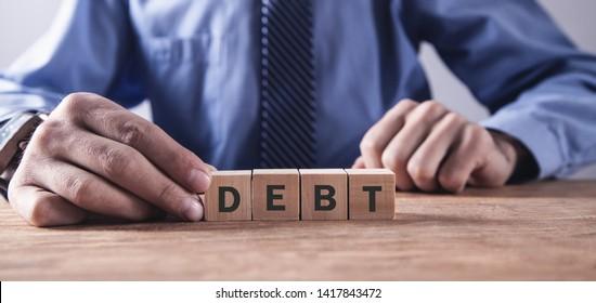 Man holding wooden cubes. Debt. Business concept