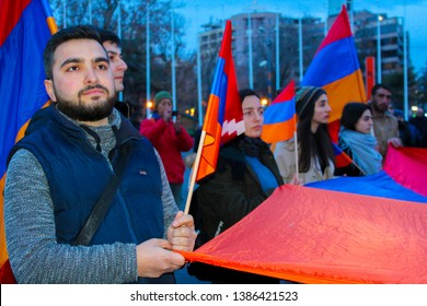 A man holds an Armenian flag in the form of a canvas  Nagorno-Karabakh, Armenia, 24 April 2019.Torchlight processions in memory of the Armenian genocide victims.