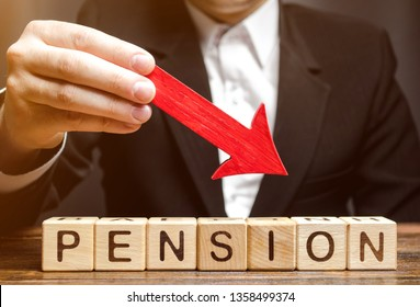 A man holds an arrow down over wooden blocks with the word Pension. Fall / reduction pension payments. Retirement. Financing retirees. Reduction of the pension fund. The low size of pensions.